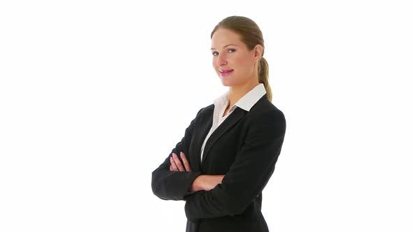 Confident businesswoman crossing arms and looking at camera