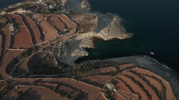Thumbnail for St Peter's Pool Famous Tourist Spot on Malta Island with Tourism in Sunset Summer Light, Aerial Wide