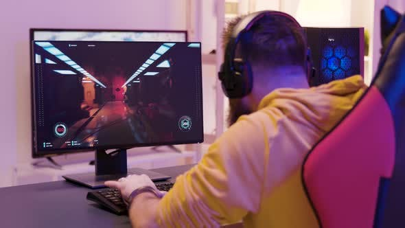 Over the Shoulder Footage of Man Playing Professional Video Games