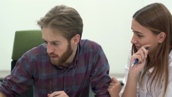 Thumbnail for Man and Woman Work in Comfortable Modern Office Discussing