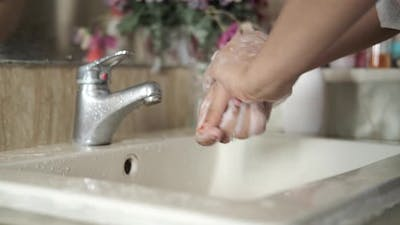 Women Washing Hands with Soap Warm Water