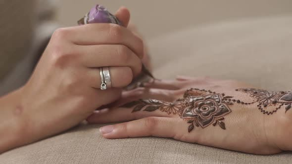 Applying Henna with Cone.