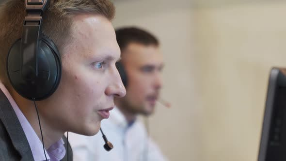 Thumbnail for Male Call Center Agent in Wireless Headset Consulting Online Client. Using Computer, Business Men