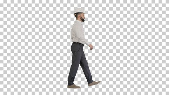 Businessman in formal wear and white hardhat walking, Alpha Channel