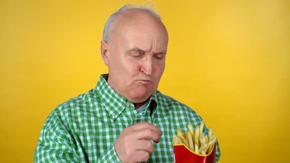 Thumbnail for Elderly Man Enjoying Tasty Fries