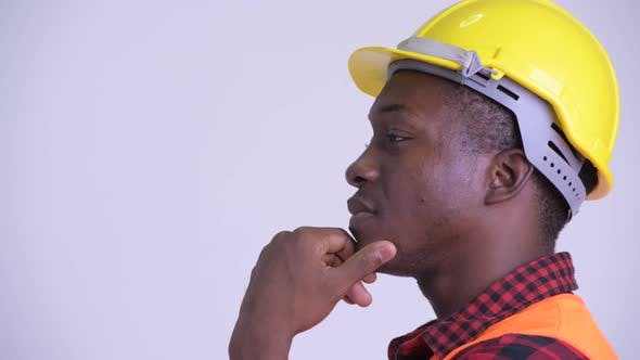 Thumbnail for Closeup Profile View of Happy Young African Man Construction Worker Thinking