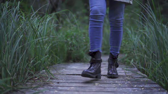 Thumbnail for Person In Blue Jeans Walking Towards The Camera