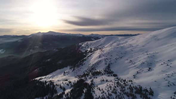 Thumbnail for Aerial View in Sunrise Winter Mountain