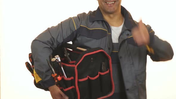 Cropped Shot of a Constructionist with Toolbox Showing Thumbs Up