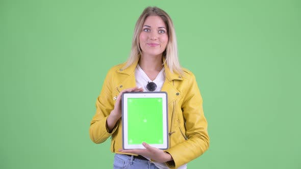 Thumbnail for Happy Young Rebellious Blonde Woman Showing Digital Tablet and Looking Surprised