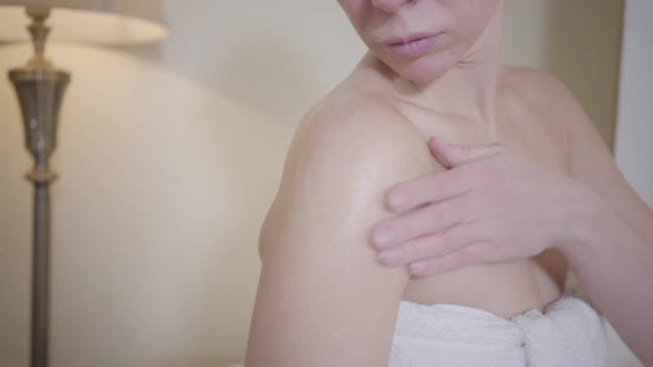 Thumbnail for Gorgeous Caucasian Woman Applying Anti-aging Body Cream. Unrecognizable Adult Lady in White Towel
