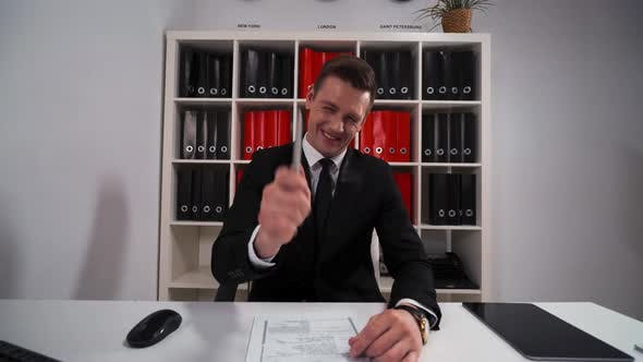 Thumbnail for Young Businessman Pointing and Laughing with Your Funny Joke