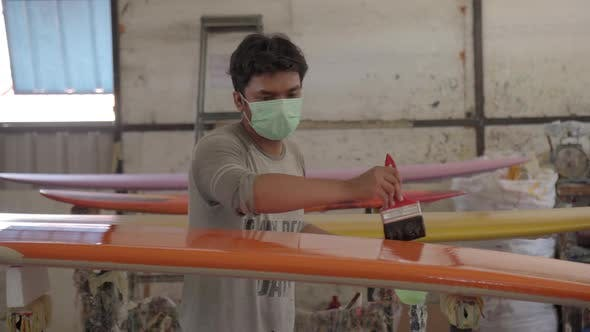Thumbnail for Young Indonesian Man Making Surfboard