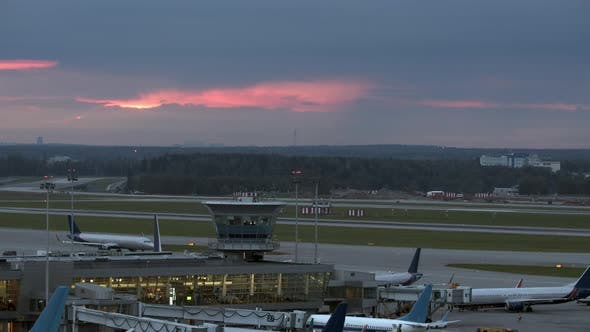 Airplane Evening Departure, Airport View with Terminal
