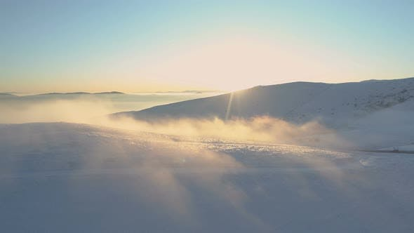 Cover Image for Beautiful Misty Sunrise in the Mountains with Snow Ridge and Clear Blue Sky