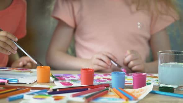 Thumbnail for Closeup of Two Young Girls Painting a Picture at Preschool Art Club, Hobby