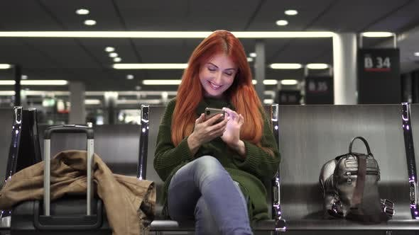 Thumbnail for Young Female Uses Phone in Airport Terminal
