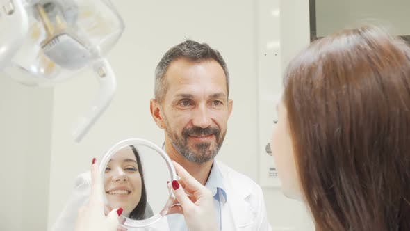 Thumbnail for Happy Mature Dentist Talking To a Patient After Medical Exam