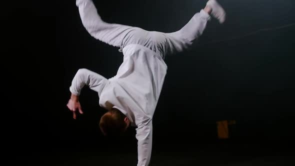 Thumbnail for Young Man Dancer Spinning Aroung on One Hand and Keeping the Balance