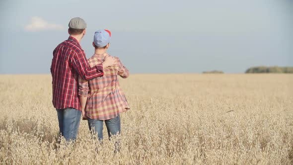 Thumbnail for Farmers Father and Son in Field