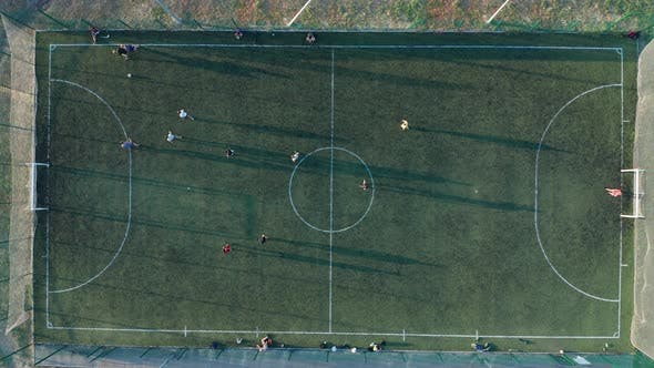 Aerial Shot Two Teams Playing Ball in Football Outdoors, Top View. Football Game Outdoors, Green