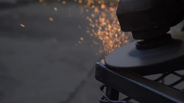 Thumbnail for Worker Using Angle Grinder In Factory Hall