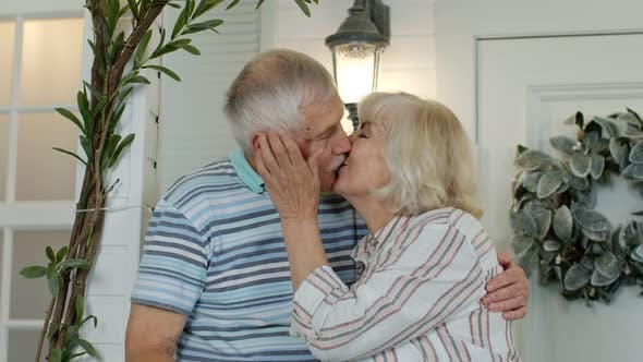Thumbnail for Senior Couple Husband and Wife Embracing and Making a Kiss in Porch at Home. Happy Mature Family