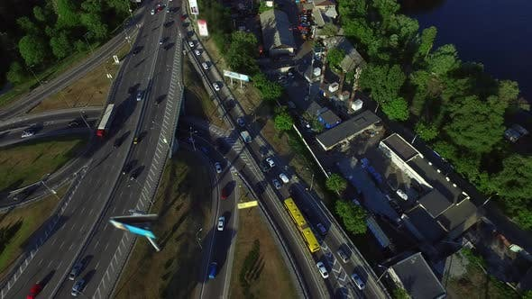 Thumbnail for Car Driving on Highway Intersection in City. Aerial View Car Traffic on Freeway