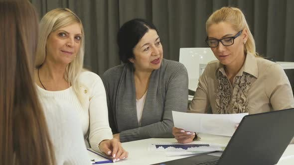 Thumbnail for Three Businesswomen Interviewing New Employee for Job at the Office