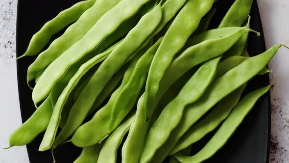 Thumbnail for Black Ceramic Plate with Fresh Green Bean Pods