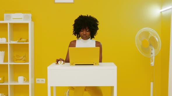 Black Woman Is Working In Creative Office