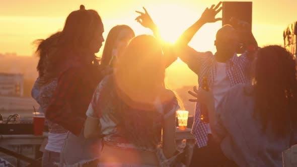 Thumbnail for Multi-ethnic Friends Celebrating at Sunset
