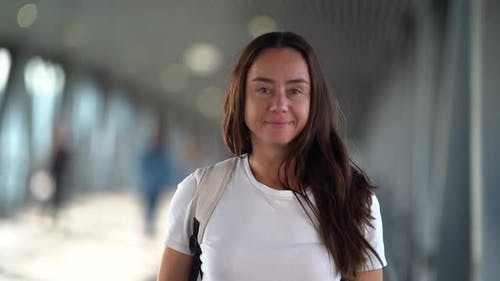 Portrait of Brunette Woman with Long Hair in Pedestrian Tunnel at Daytime