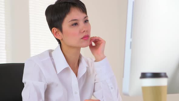 Thumbnail for Chinese businesswoman analyzing data