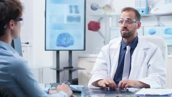 Cover Image for Physician Wearing Augmented Reality Glasses Showing Something To a Patient