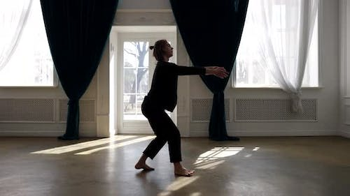 Artistic Male Dancer is Dancing Alone in Rehearsal Room Contemporary Choreography