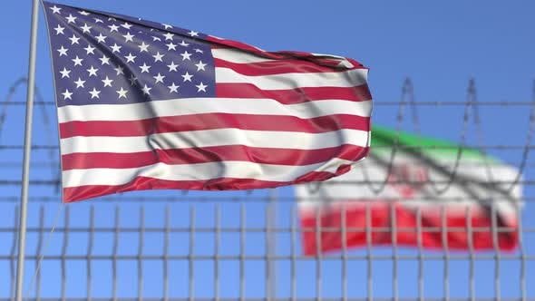 Thumbnail for Waving Flags of the USA and Iran Separated By Barbed Wire Fence