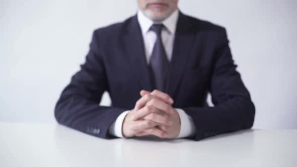 Thumbnail for Respectable Businessman Sitting at Office Table Ready to Discuss Cooperation