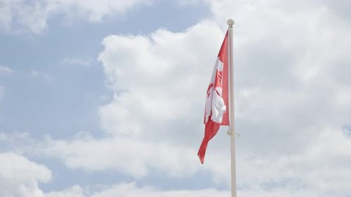 Fabric of Canadian flag is waving on the wind 4K 2160p 30fps UltraHD footage - National flag of Cana