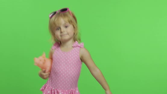 Thumbnail for Child in Pink Swimsuit Playing with a Toy Pig. Chroma Key