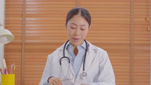Camera view Asian doctor woman smile meeting online with patient to consult about health
