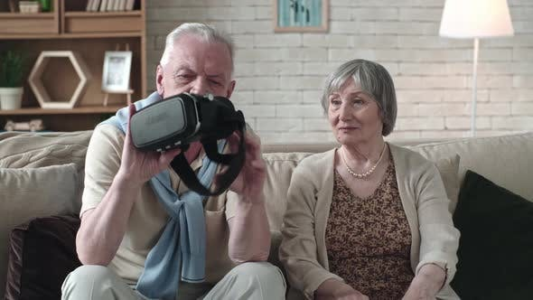 Thumbnail for Senior Couple Inspecting VR Headset