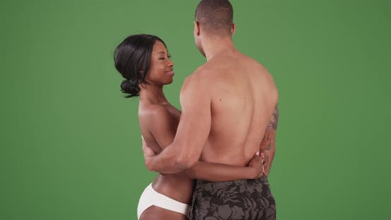 Thumbnail for African American couple embracing each other in their swim suits on green screen