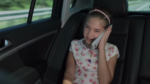 Thumbnail for Adorable Girl Talking on Cellphone in Luxury Car