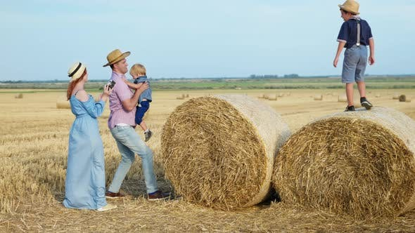 Thumbnail for Family Weekend, Parents Play in Wheat Field with Their Children