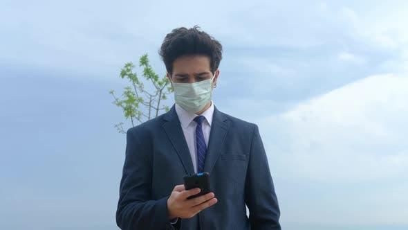 Masked Businessperson Talking Phone
