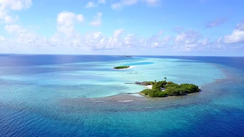 Wide overhead abstract view of a paradise sunny white sand beach and blue sea background