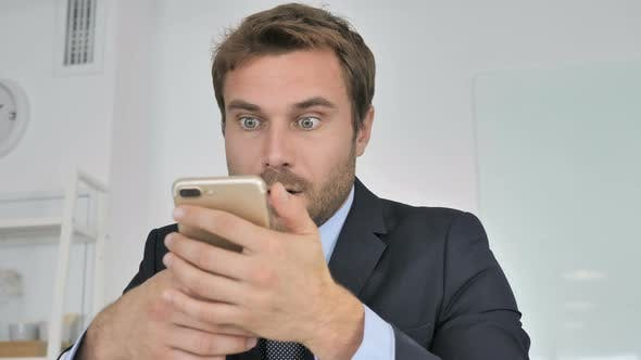 Close Up of Businessman Using Smartphone, Wondering in Shock