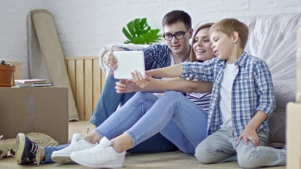 Thumbnail for Young Family Taking Pictures on Tablet