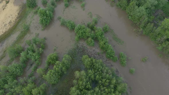 Thumbnail for Above flooded coasts of river after heaver rain 4K drone footage